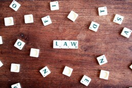 Scrabble tiles that spell out law