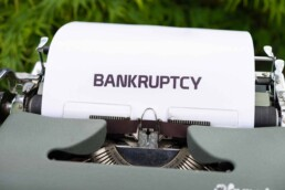 Type writer with a paper that says bankruptcy